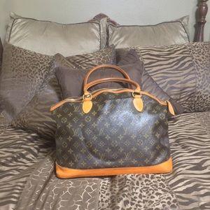 Authenticated Louis Vuitton Horizontal Lock It